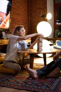 Woman playing jengga on coffee table